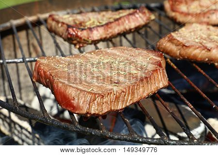 Grilled Beef Steaks Cooking On Barbecue Grill