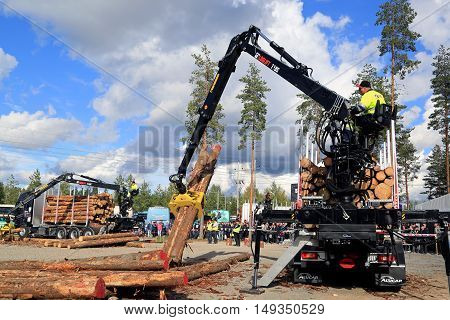 JAMSA FINLAND - SEPTEMBER 2 2016: Two finalists compete in the Finnish Championships in Log Loading 2016 held at FinnMETKO 2016.