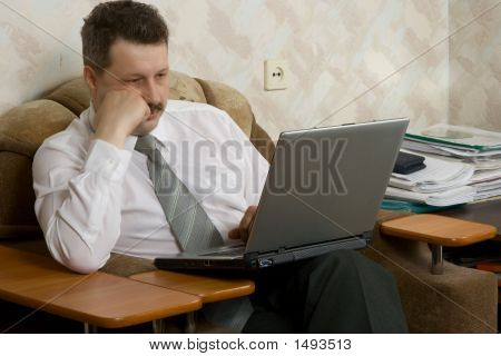 Young The Man Working On Notebook At Home