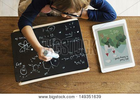 Little Girl Writing Blackboard Concept
