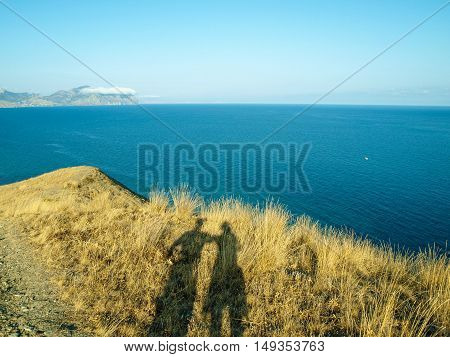Mean winter sun makes walking on the hills in the Crimean giants