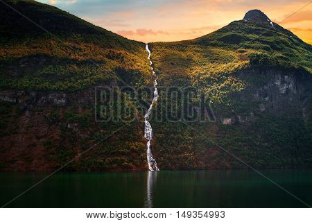 Waterfall Over The Geiranger Fjord