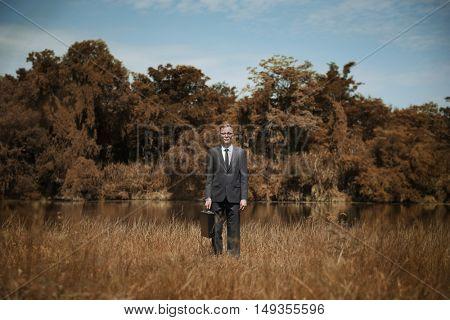 Businessman Standing Field Brown Grass Concept