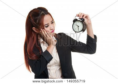 Young Asian Business Woman Is  Stressed With A Clock.