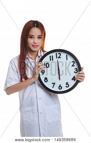 Frustrated Young Asian Female Doctor With A Clock.