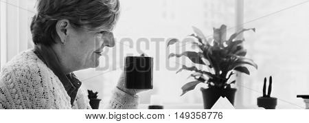 Senior Woman Casual Pensioner Reading Dining Concept