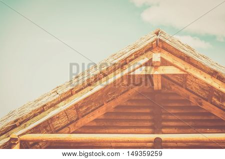 vintage summer wooden roof. cloudy blue sky.