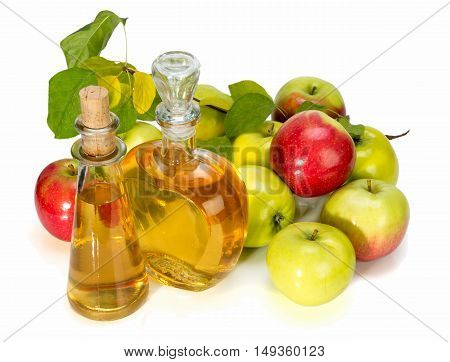 Apple Cider Vinegar In A Glass Vessel And Red And Green Apples