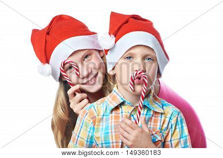 Children In Red Caps With Christmas Sweets Isolated