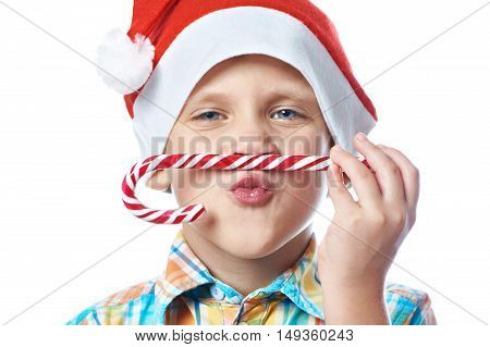 Little Boy In New Year's Red Cap With Christmas Candy Cane Isolated