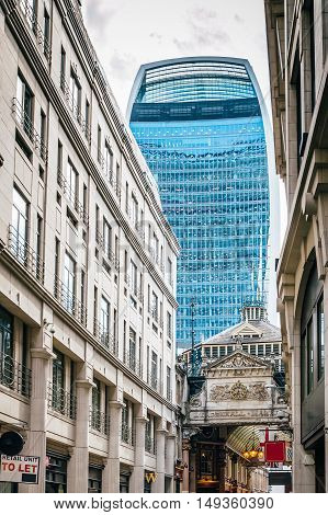 LONDON UK - AUGUST 21 2015: Street in the city of London with the contrast between historical buildings and new skyscrapers at Leadenhall Market