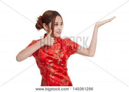 Asian Girl In Chinese Cheongsam Dress  Thumbs Up With  Blank Space On Her Hand.