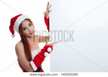 Asian Christmas Girl With Santa Claus Clothes Point To  Blank Sign.
