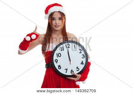 Asian Christmas Santa Claus Girl  Thumbs Up And Clock At Midnight.