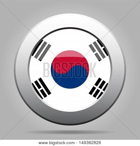 metal button with the national flag Republic of Korea on a gray background