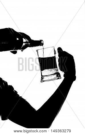 silhouette of a Beer that is Pouring into glass