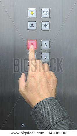 businessman hand press 7 floor in elevator