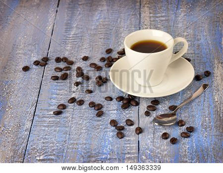 Morning coffee. A cup of coffee on the old wooden background. Christmas. Aromas holiday. The mood is festive night.Warmth and comfort in the cold winter.Close-up. / selected focus/