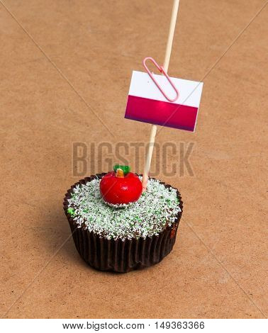 Flag of monaco. Apple Cupcake with red apple shape bonbon on the top