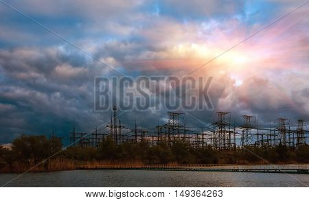 High-voltage power line close-up on a background of clouds
