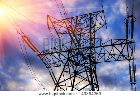 High-voltage power line close-up on a background of clouds at sunset