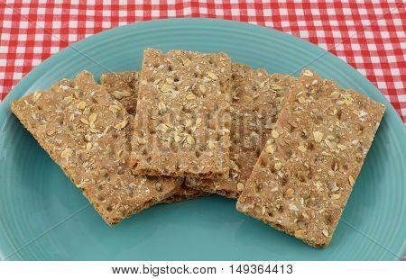 Multi grain whole grain crispbread crackers on blue plate
