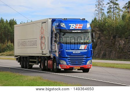 PAIMIO, FINLAND - SEPTEMBER 9, 2016: New blue DAF XF reefer truck of Torbjorn Bay moves along freeway in South of Finland.