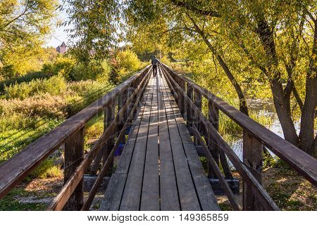 wide angle wooden bridge over river.