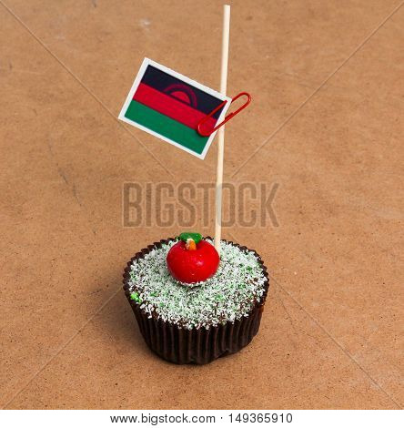 Flag of Malawi. Apple Cupcake with red apple shape bonbon on the top
