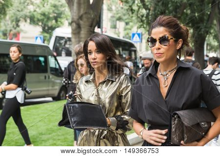 Fashionable Women Posing During Milan Fashion Week
