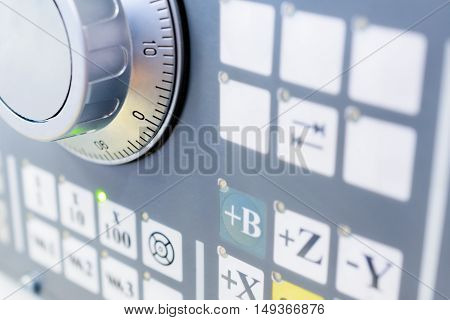 Detail of CNC machine control panel. Shallow depth of field.