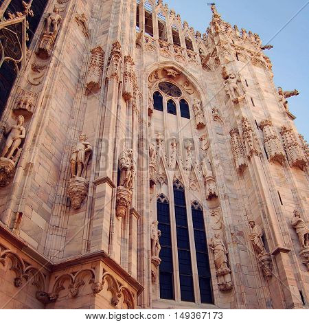 Milan Cathedral. Fragment. Aged photo. Duomo di Milano gothic cathedral church. One of Milan Tourist Attractions. Italy.