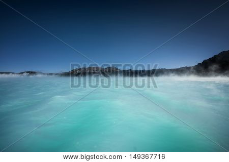 Thermal lagoon under deep blue sky outdoors