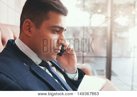 Close up of businessman talking on phone. Negotiation. Communication with partners.