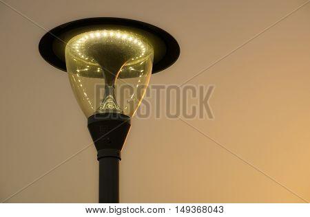 Street lamp post giving light on pavement