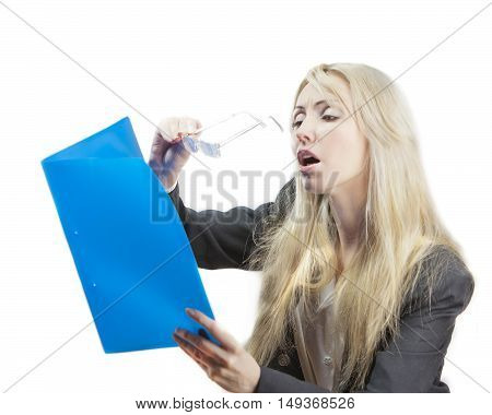 The blonde in a business suit looks in the folder with documents through glasses