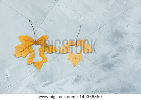 Lettering i love on maple leaves on a concrete background. Horizontal orientation.