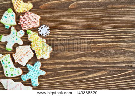 The Christmas cookies on a wooden background