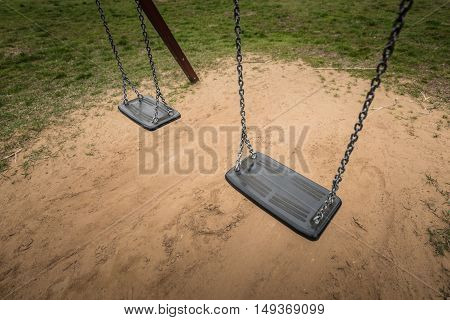 Playground swing in the park with sunlight