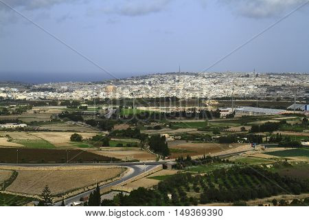 Sunny view of surrounding fields from tower of Mdina Malta.