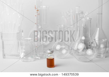 Research lab assorted glassware equipment in blue tone
