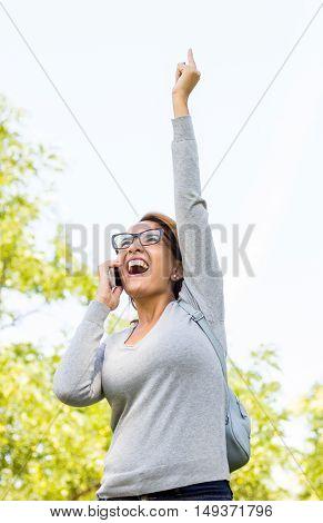 Beautiful Woman Celebrating Success News With Arms Up