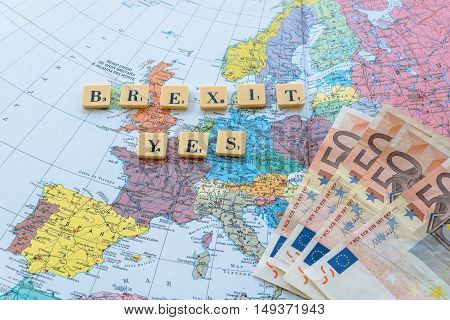 London UK - June 12 2016: Brexit Yes words on european map with euro money. The United Kingdom European Union membership referendum on 23 June 2016