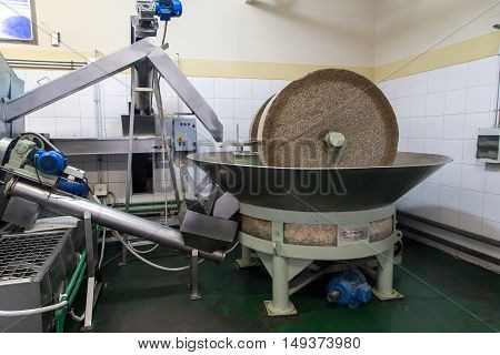 Mendoza, Argentina - November 23, 2015: A grinding stone inside an olive oil factory