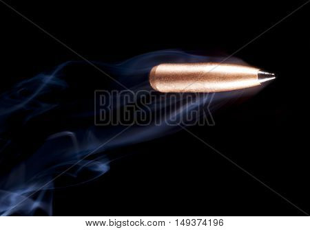 One copper plated bullet with a polymer tip and smoke