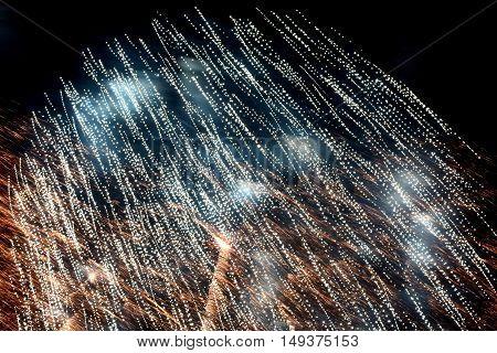 fireworks in the night sky bright sparks rain