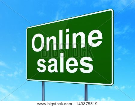 Marketing concept: Online Sales on green road highway sign, clear blue sky background, 3D rendering