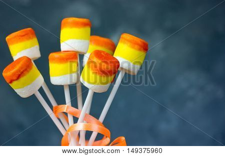 Candy corn marshmallow pops Halloween food recipe background