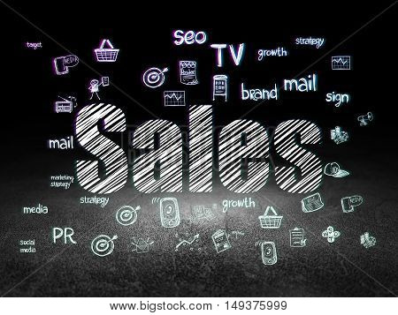 Advertising concept: Glowing text Sales,  Hand Drawn Marketing Icons in grunge dark room with Dirty Floor, black background