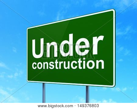 Web development concept: Under Construction on green road highway sign, clear blue sky background, 3D rendering